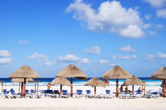 Free stock photos of [Cancun resort with beach beds and umbrellas]