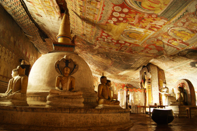 Free stock photos of [Golden Temple of Dambulla with beautiful Buddha statues and ceiling murals]