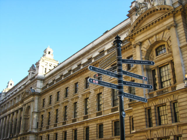 Free stock photos of [London signposts pointing in many directions]
