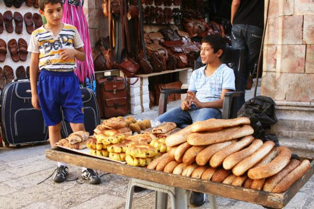 Free stock photos of [Bread-selling boy in Jerusalem]